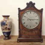 clock-and-vase